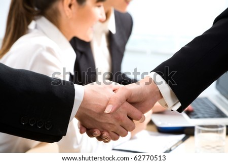 Image of business handshake after signing contract