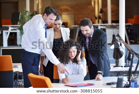 Shutterstock Image of business partners discussing documents and ideas at meeting