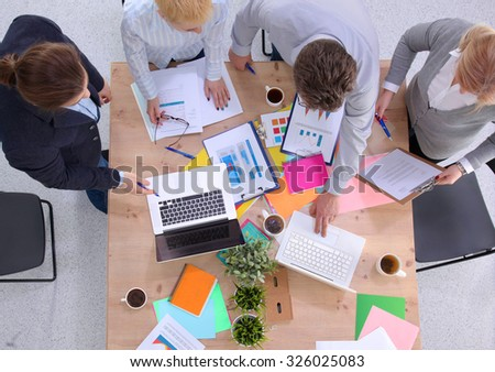 Image of business partners discussing documents and ideas at meeting #326025083
