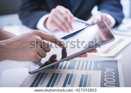 Image of business partners discussing documents and ideas at meeting #427592803
