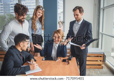 Image of business partners discussing documents and ideas at meeting #717095401