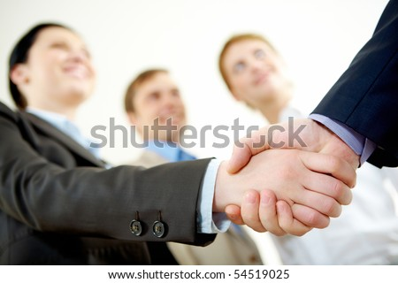 Image of business partners handshake on signing contract