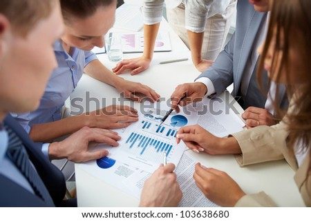 Image of business people discussing business documents at meeting
