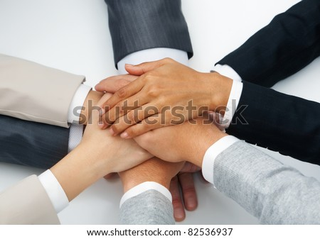Image of business people hands on top of each other symbolizing partnership - stock photo