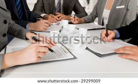 Image of business people hands with ballpoints writing on papers while planning work #29299009