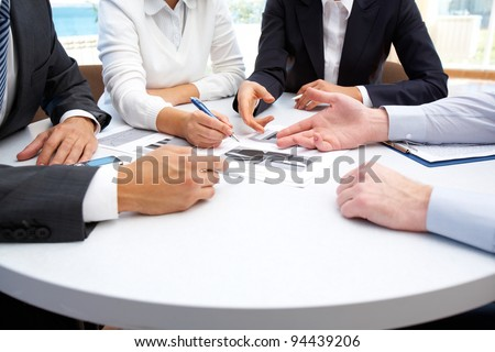 Image of business people hands working with papers at meeting