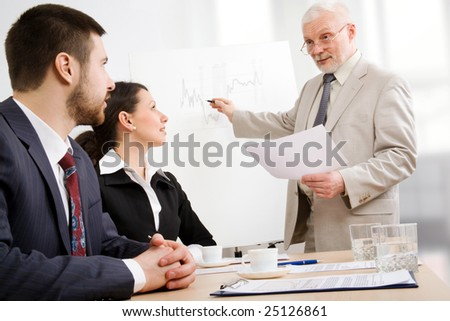 Image of business people listening their boss at seminar
