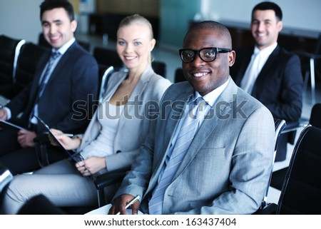 Image of business people sitting in rows at conference