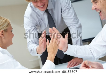 Image of business people with their palms opposite each other symbolizing support
