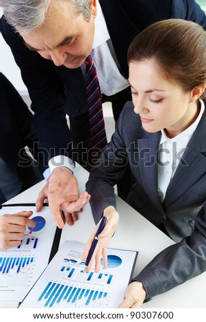 Image of business people working with documents