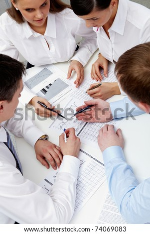 Image of business team during discussion of business papers