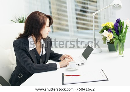 Image of business woman in the workplace - stock photo
