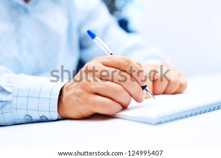 Image of businessman hand writing