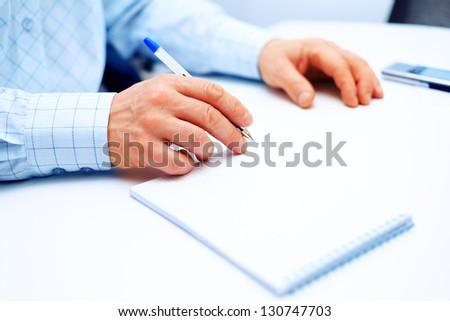 Image of businessman hand writing