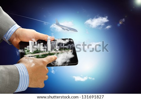 Image of businessman hands touching pad with virtual illustration