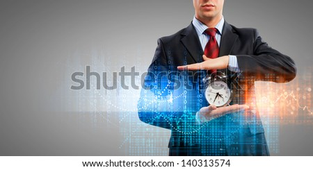 Image of businessman holding alarmclock against illustration background