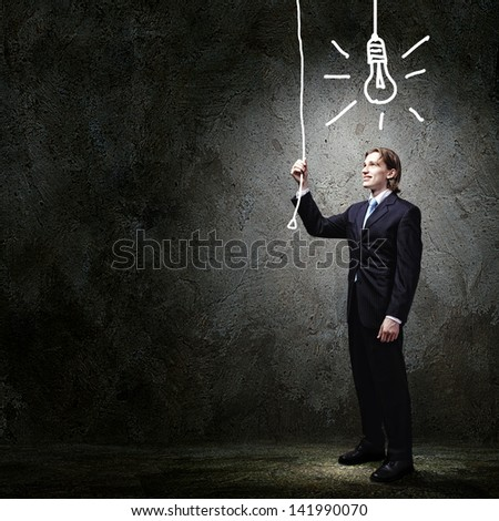 Image of businessman in black suit against dark background