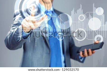 image of businessman touching screen with finger holding pad