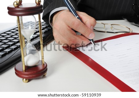 Image of businessmans hand ready to make signature