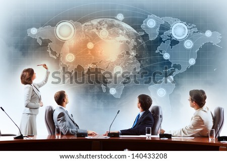 Image of businesspeople at presentation looking at virtual project