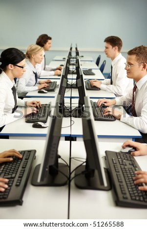 Image of businesspeople typing on the keyboards in line