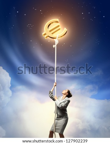 Image of businesswoman climbing the rope attached to euro sign