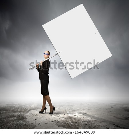 Image of businesswoman holding blank banner. Place for text