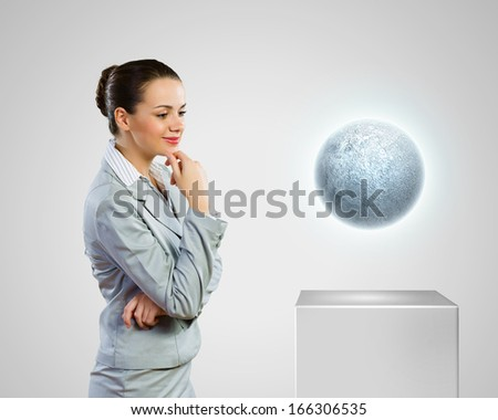 Image of businesswoman looking at moon. Astrology