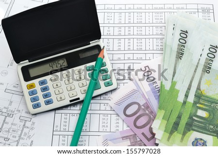 Image of calculator with money and calculations