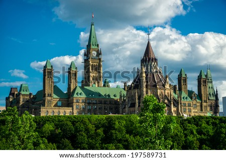Image of Canada's Parliament Hill and Parliament Buildings, the seat of the federal government of Canada, taken from the back side of the buildings.