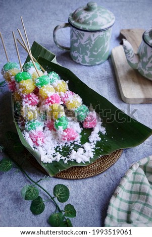 Image of Cenil or boiled tapioca flour dough with grated coconut topping. Traditional snack from Indonesia, usually sold at the traditional market. lt is kind of chewy and sweet snack.  Stock photo ©