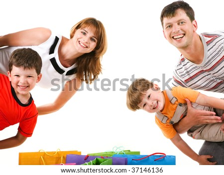 Image of cheerful family members standing looking at camera with happy expression - stock photo