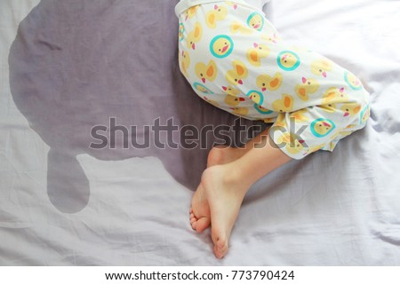 Image of child pee on the mattress.The picture of bed-wetting situation in 4 or 5 years old girl.Girl wet the bed while she was sleeping.Selective focus