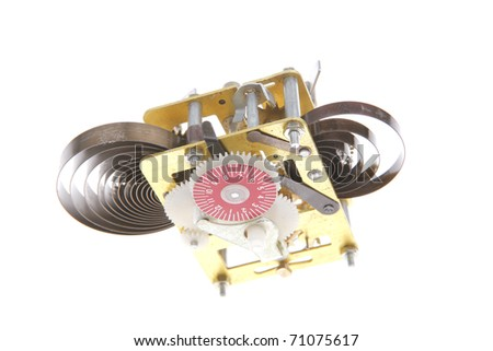 image of clock mechanism inside over white background . shallow dof