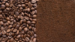 Image of coffee beans and ground instant coffee. Background of coffee beans and coffee powder