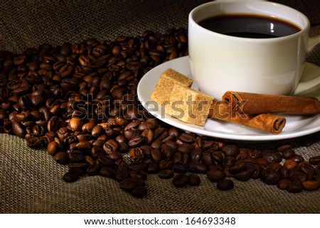 Image of coffee beans and white cup
