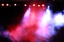 Image of colorful concert lighting against a dark background