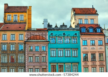Image of colorful old houses in the main town square in Warsaw, Poland enhanced by use of HDR techniques