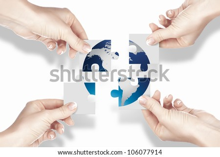 Image of colour puzzle pieces and human hand