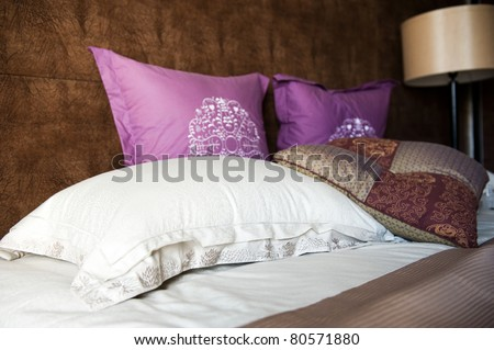 Image of comfortable pillows and bed.