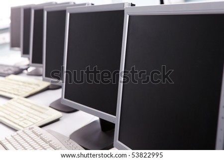 Image of computers on the table in line