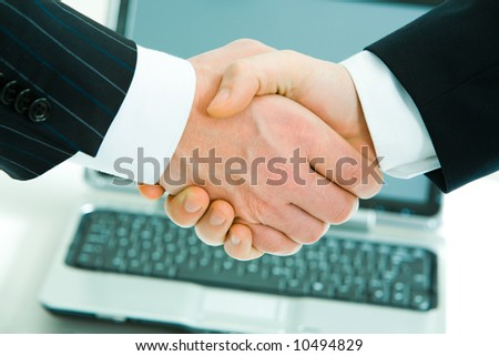 Image of conceptual gesture: businesspeople shaking hands