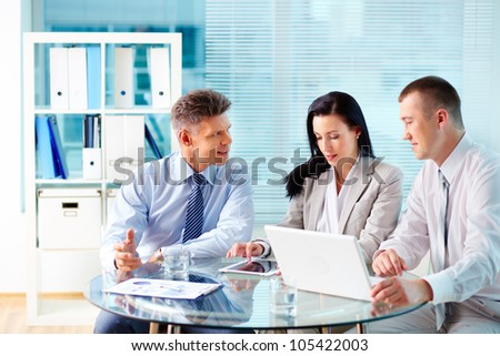 Image of confident partners discussing new project at meeting