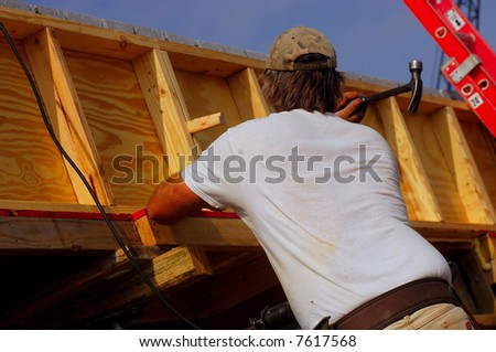 Image of Construction Worker Building a House