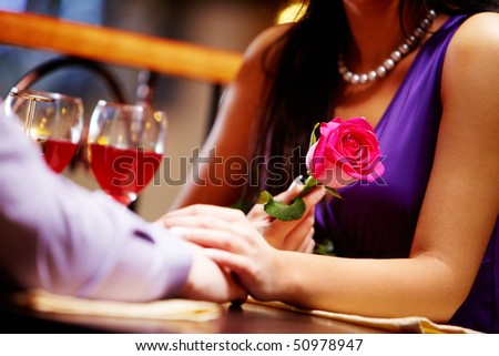 Image of couple? hands together during Valentine?s day