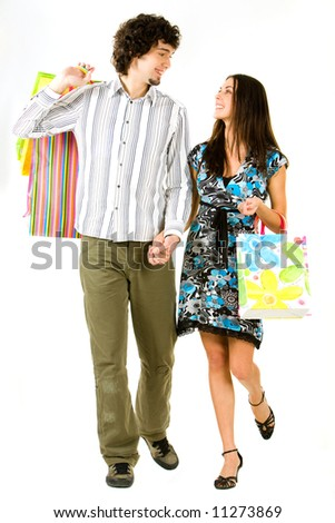 Image of couple holding the bags and hands together walking