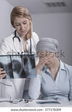 Image of crying woman having brain tumor
