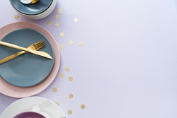 image of cutlery sets and plates. party theme