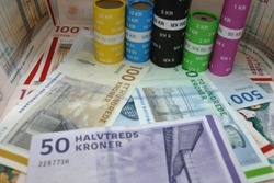 Image of danish banknote krone and danish coins.