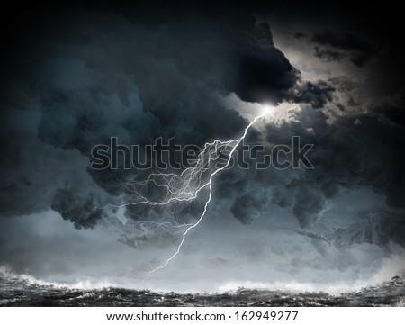 Image of dark night with lightning above stormy sea